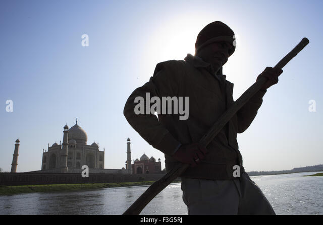 Man rowing boat in Yamuna river at Taj Mahal Seventh Wonders ; Agra ; Uttar Pradesh ; India UNESCO World Heritage - Stock Image