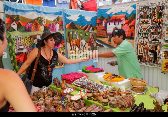 Chile Arica Paseo Peatonal 21 de Mayo pedestrian mall gift shop business shopping souvenir Hispanic man woman folk - Stock Image