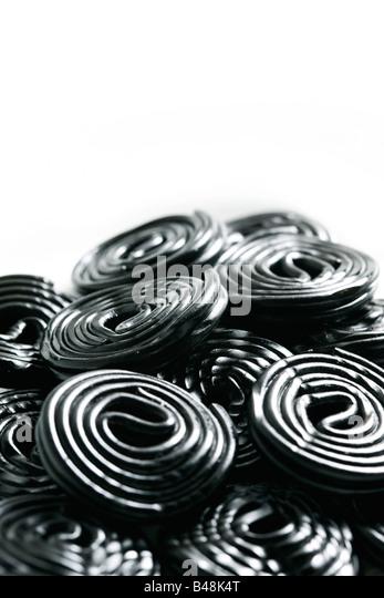 Rolls of tasty liquorice candy rolls isolated on white - Stock-Bilder