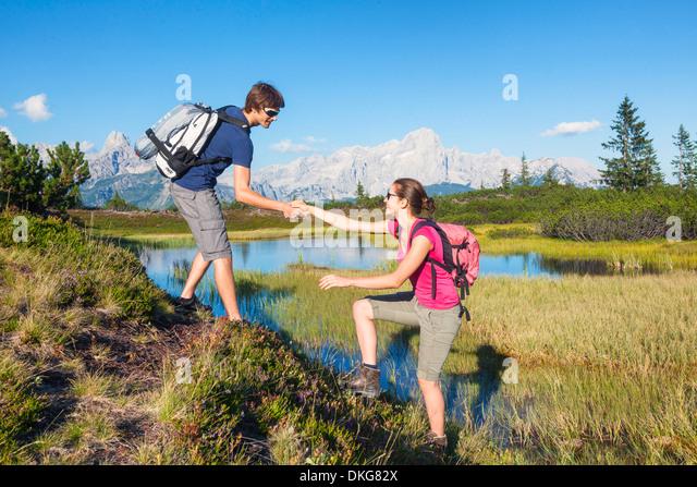 Young couple hiking, Bischofsmuetze, Gosaukamm und Dachstein, Salzburger Land, Austria, Europe - Stock Image