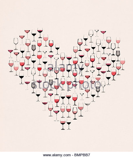 Red wine in glasses forming heart - Stock Image