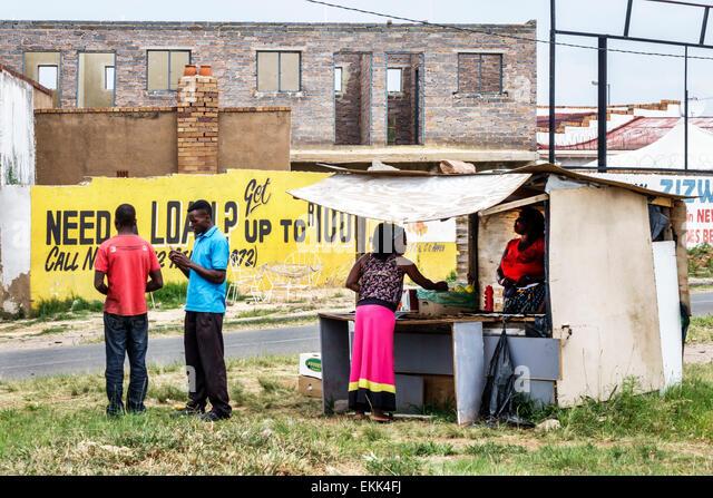 South Africa African Johannesburg Soweto Black woman street vendor man - Stock Image