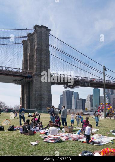 Family picnic Brooklyn Bridge park, NYC, USA - Stock Image