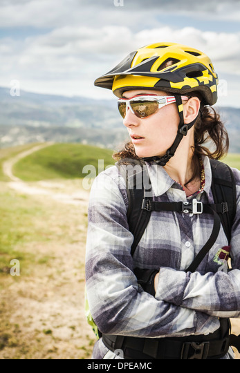 Cyclist in full gear, Monterey County Park, California, United States of America - Stock Image