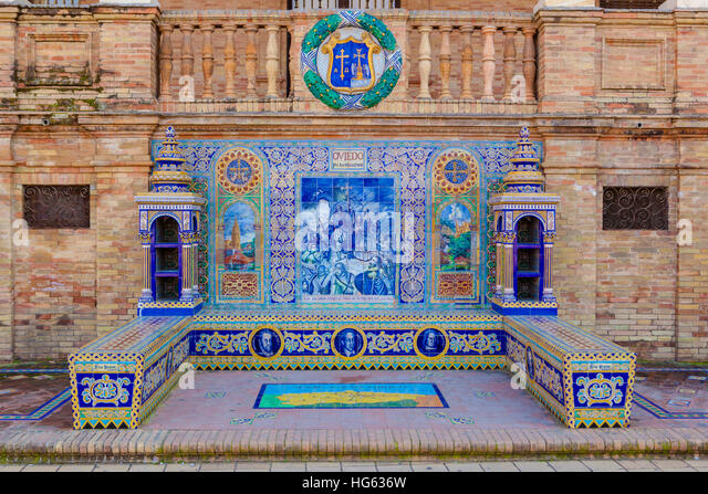 Glazed tiles bench of spanish province of Oviedo at Plaza de Espana, Seville, Spain - Stock Image