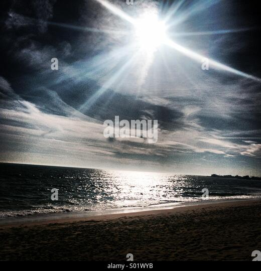 Sunny day with clouds on beach in Rhode island - Stock Image