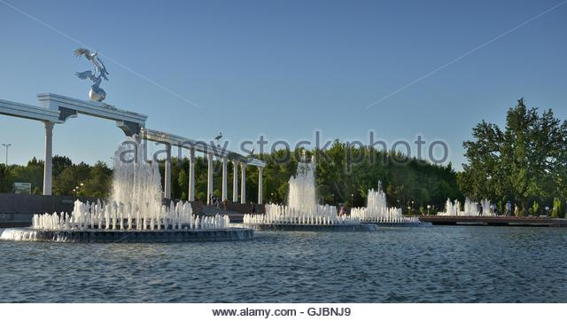 The large fountain in front of the main square in Tashkent. Square (Mustaqillik Maydoni) is the Central square in - Stock Image