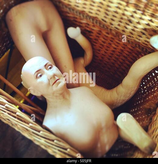 A mannequin in a basket. - Stock Image