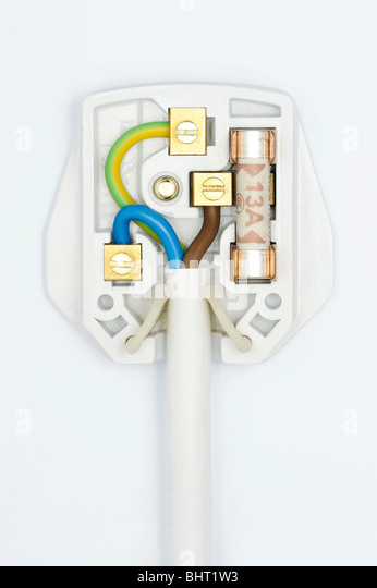 A plug showing the wiring inside - Stock Image