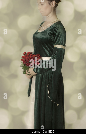 a woman in a Victorian dress with a bouquet of roses - Stock-Bilder