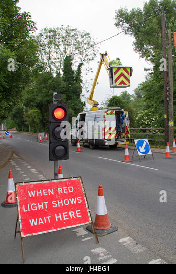 Temporary traffic lights for a cherry picker working on power lines. - Stock Image