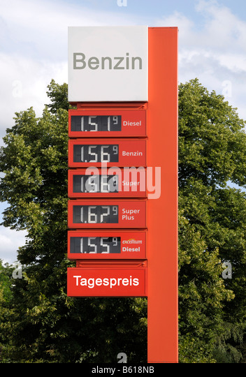 Daily petrol prices shown on a sign at a German petrol station - Stock Image
