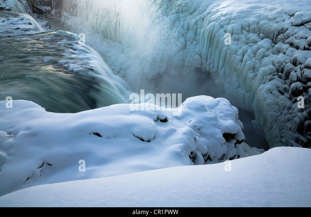Steam rising from glacial hot spring - Stock Image