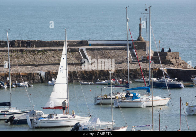 Newquay Harbour on a sunny day in the summer, with people on their boats, yachts - Stock Image