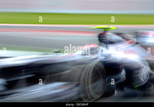 blurred Williams Formula One race car during the Spanish Formula One Grand Prix race 2013 - Stock-Bilder