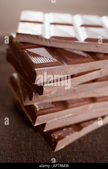 Chocolate bars in a pile - Stock Image