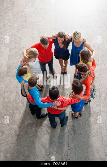 Overhead view of people in circle - Stock Image