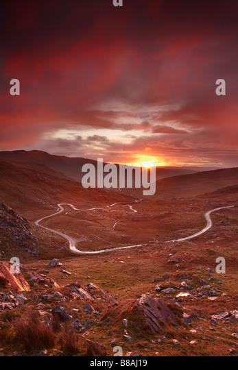 the road over the Healy Pass at dawn, Caha Mountains, Beara Peninsula, Co Cork, Ireland - Stock Image