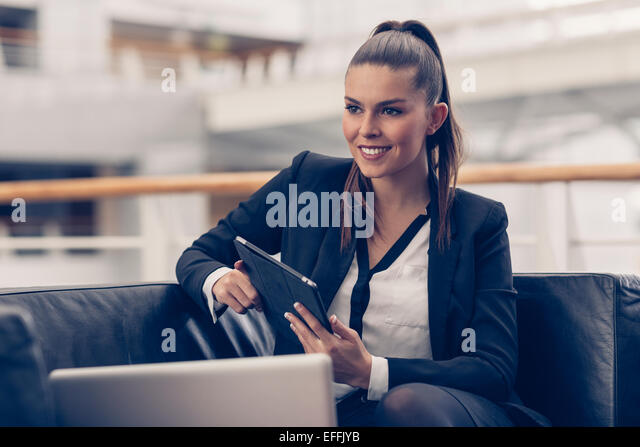 Portrait of a businesswoman with a digital tablet - Stock-Bilder