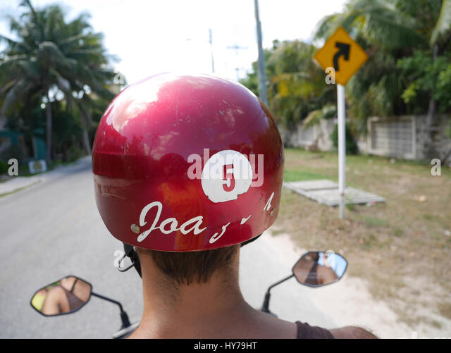 Red helmet scooter driver - Stock Image