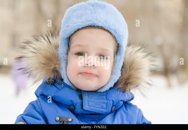 Portrait of a three-year girl in the winter - Stock Image