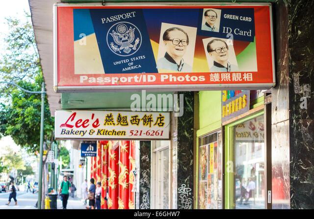 Hawaii Oahu Hawaiian Honolulu Chinatown North King Street businesses signs passport business green card ID card - Stock Image