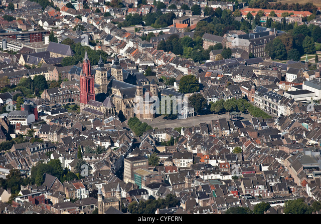 The Netherlands, Maastricht, church called St Servatius Basilica, Church left with red tower called St Jans. Aerial. - Stock Image