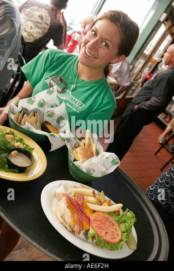 Cleveland Ohio, The Winking Lizard Restaurant, waitress, tray, food, - Stock Image