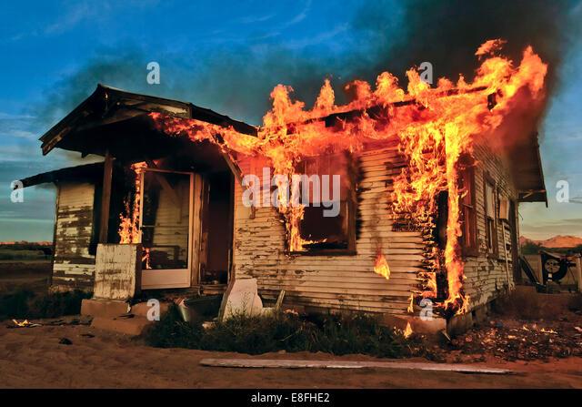 USA, Arizona, Maricopa County, Gila Bend, Burning Down House - Stock Image