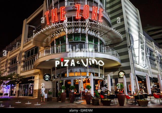 Johannesburg South Africa African Rosebank The Zone Mall Piza e Vino restaurant front entrance night nightlife - Stock Image