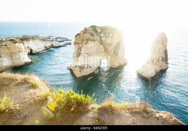 Pigeon rock with backlight sunlight, Beirut, Lebanon - Stock Image