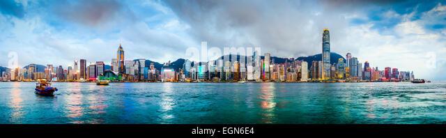 Hong Kong, China skyline panorama from across Victoria Harbor. - Stock Image