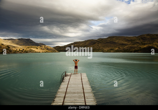 Torres del Paine National Park Chile. young man diving mountains Torres del Paine lake - Stock Image