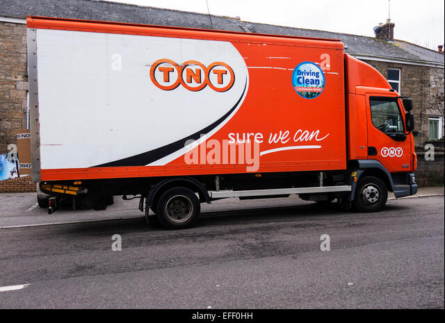TNT delivery van parked on road - Stock Image