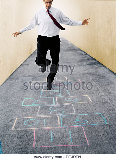 Businessman Playing Hopscotch - Stock Image
