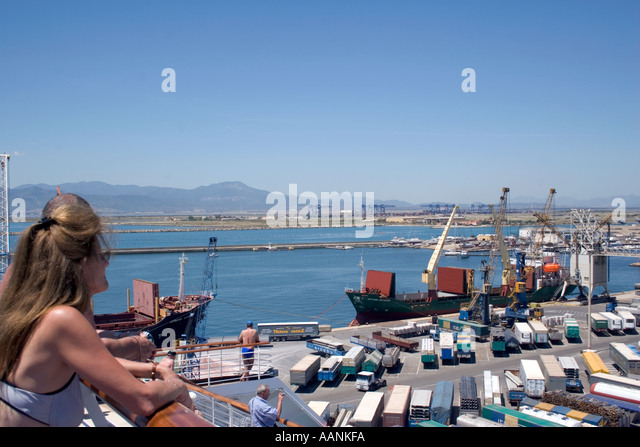 Cruse Ship Passengers watches her arrival in Cagliari Harbour, Sardinia, Mediterranean Sea, Europe,  cruiseship - Stock Image