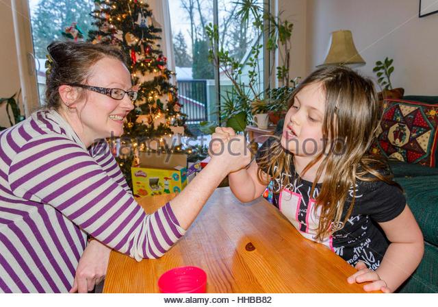 Friendly family arm wrestling - Stock Image