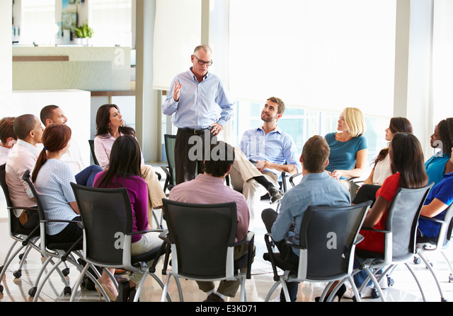 Businessman Addressing Multi-Cultural Office Staff Meeting - Stock Image