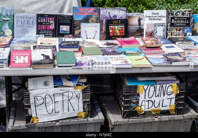 New York New York City NYC Queens Long Island City street vendor used books poetry table display sale - Stock Image