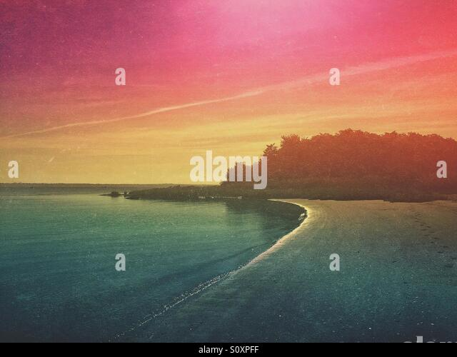 Colorful Sky Along the Shore - Stock Image