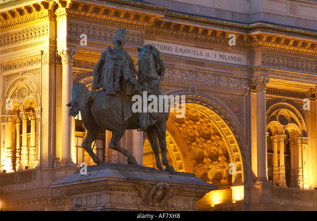Statue to Vittorio Emanuele II and facade of Galleria Vittorio Emanuele II Piazza del Duomo Milan Lombardy Italy - Stock Image