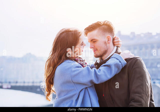 affectionate couple, portrait of young happy man and woman, love in the city - Stock Image