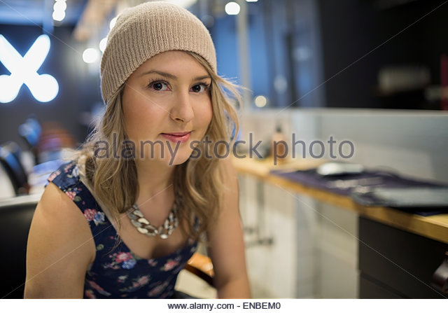 Close up portrait confident hipster hairstylist - Stock Image