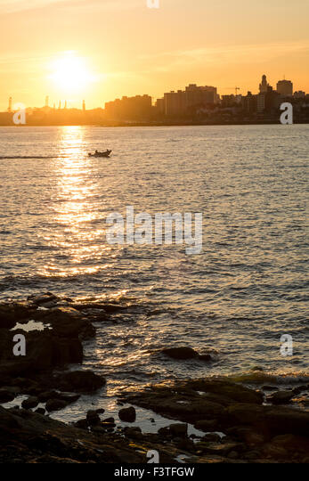 Sunset over Rio de la Plata with Montevideo skyline in the background - Stock Image