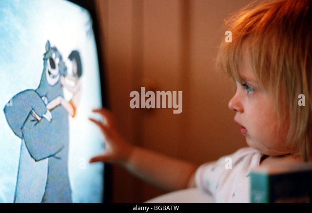 Photograph of child watching tv television kids cartoons looking - Stock-Bilder