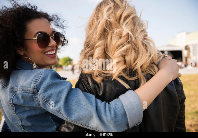 Two friends starting their best party - Stock Image