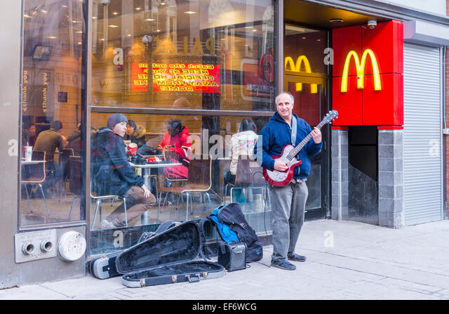 Busking busker stock photos busking busker stock images for Mcdonalds norwich ny