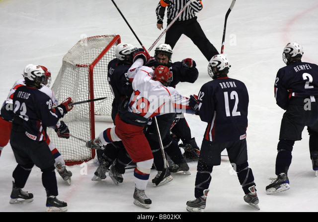 Fight in a U18 ice-hockey game between USA and Russia. - Stock Image