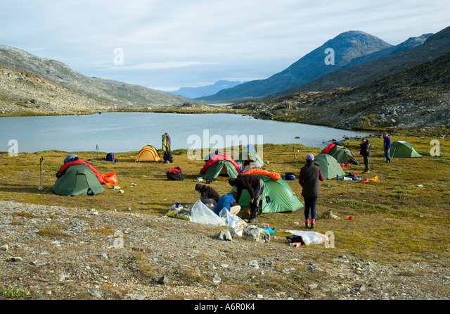 Trekking group camped near Sermilik Fjord, East Greenland - Stock Image