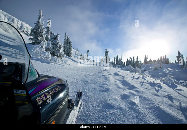 Snowmibiling up top Grey Mountain near Whitehorse - Stock Image